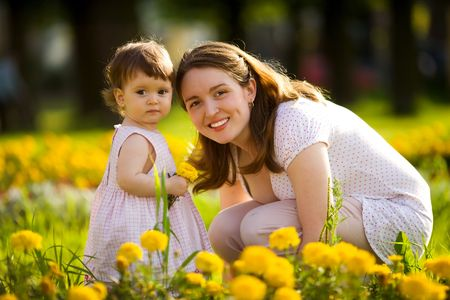 Happy mother walking with daughter in park outdoors photo
