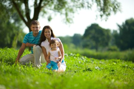 Happy Family posing together summer outdoors  Stock Photo
