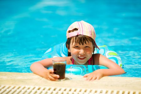 Little girl drinking soda in pool summer holidays Stock Photo - 6952458