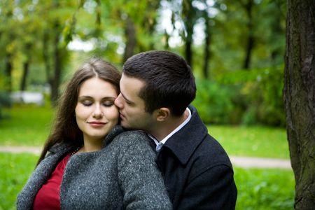 inlove: Two young lovers enjoying each other in park