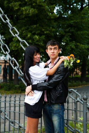 Young Couple spending time on date summer park photo