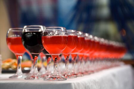 pink wine: Glasses of red and pink wine in a row on table
