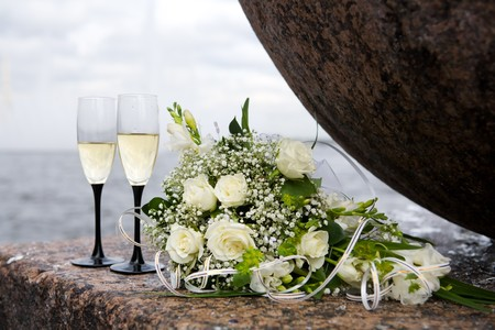 wedding bouquet and two champagne glasses outdoors Stock Photo - 7093402