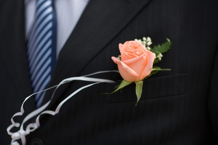 buttonhole: buttonhole with rose detail of grooms wedding dressup Stock Photo