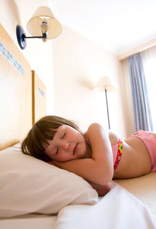 Six years girl sleeping in summer hotel in swimwear Stock Photo - 7240177
