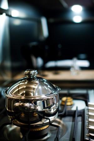 new stainless steel saucepan on modern kitchen range Stock Photo - 7117420