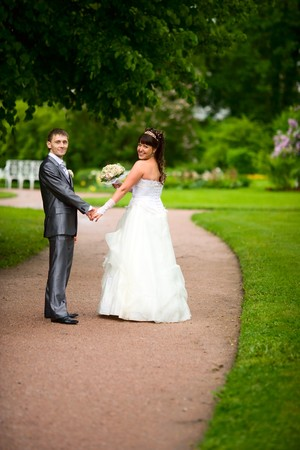 Bride and groom posing summer park outdoors Stock Photo - 7240219