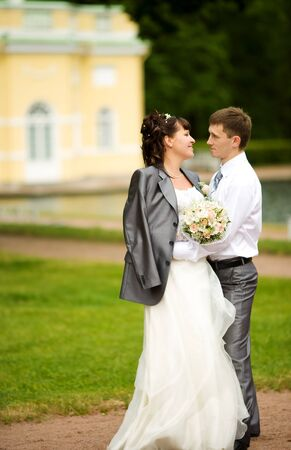 Bride and groom posing summer park outdoors Stock Photo - 7240185