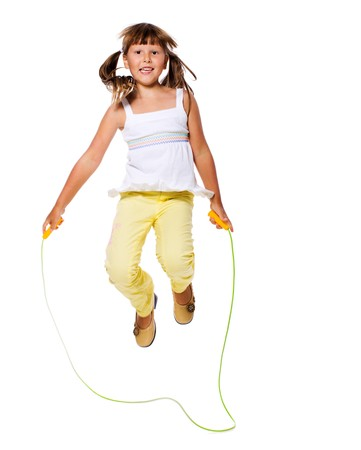 Seven years Girl jumping with skipping rope isolated on white photo