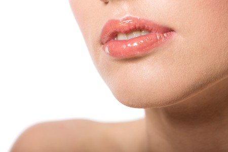 Young womans Lips close up isolated on white photo