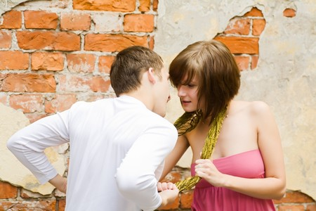 Happy young couple spending time together outdoors photo