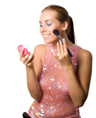 Young beautiful woman applying makeup and smiling cutout photo