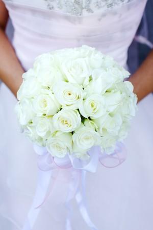 bridal bouquet: Bride holding roses vivid flowers bouquet in hands