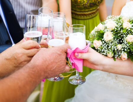 congratulating: People congratulating new married couple with Wedding Champagne Stock Photo