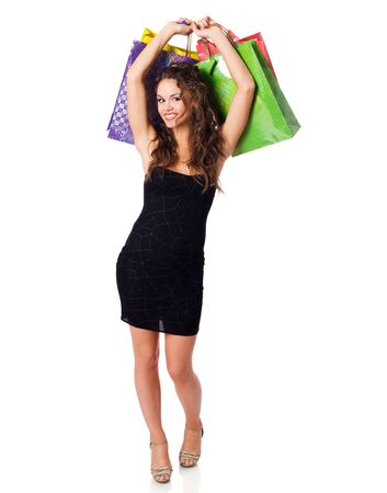 Young Woman shopping holding bags isolated on white Stock Photo
