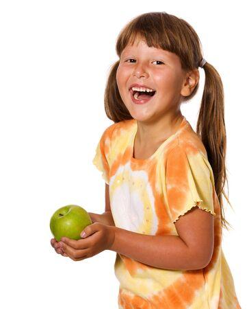 Six years Girl holding apple isolated on white photo