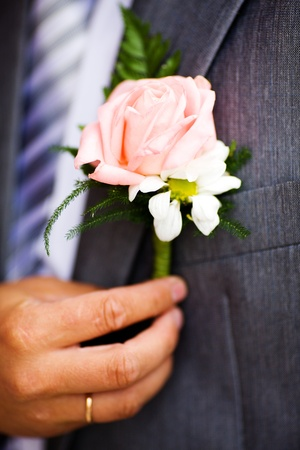 dressup: buttonhole with rose detail of grooms wedding dressup Stock Photo