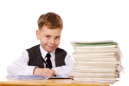 Smiling kid studying isolated on white photo
