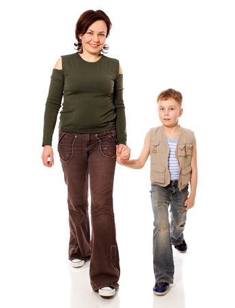 Mother and son walking together isolated on white Stock Photo