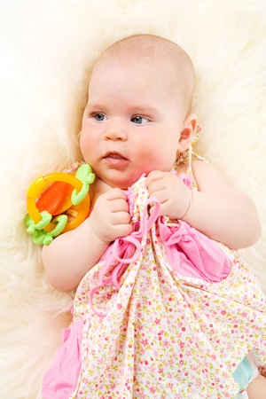 Six month Baby girl playing with toys photo