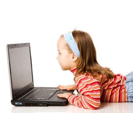 writing activity: Girl typing message on laptop isolated on white Stock Photo