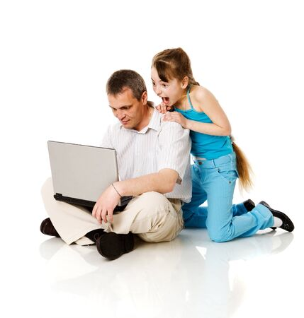 internet shopping: Father and daughter shop online isolated on white