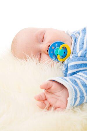 Sleeping Baby lying down on fluffy fur Stock Photo - 8485122