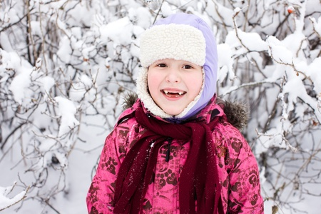 Seven years girl smiling cold sunny day outdoors photo