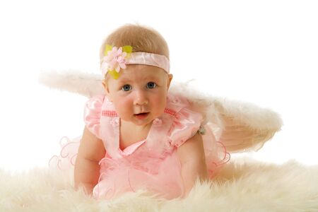 Baby girl wearing Angel wings isolated on white photo