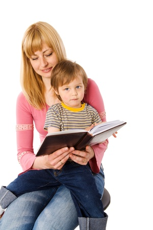 Mother reading book to her son isolated on white Stock Photo - 8705446