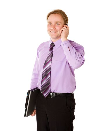 Businessman talking on cell phone holding laptop isolated photo