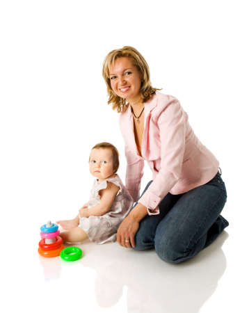 Mother playing with baby girl sitting isolated on white Stock Photo - 8826404