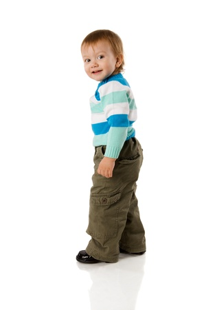 Two years boy standing turning back isolated on white Stock Photo