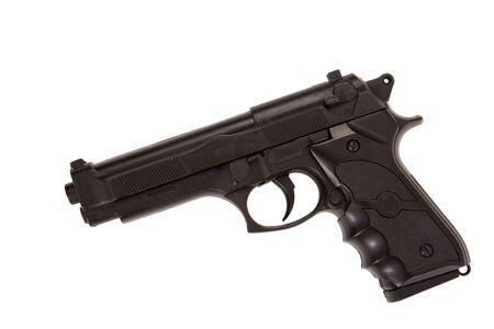 pistola: Perfil de ca��n negro acostado aislado en blanco
