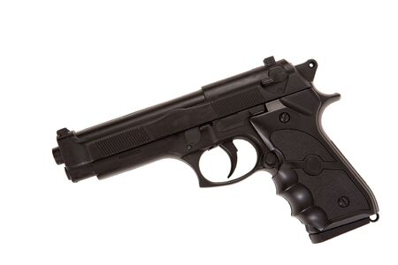 pistole: Profilo di pistola nera sdraiato isolato sul bianco