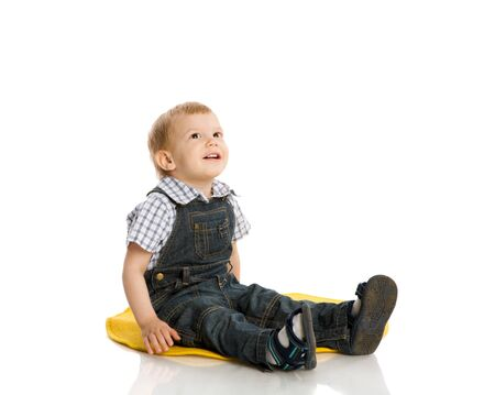 two years: Two years boy sitting on floor isolated on white Stock Photo