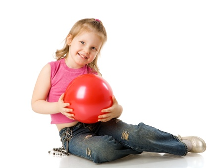 cheerful five years Girl holding ball isolated on white photo