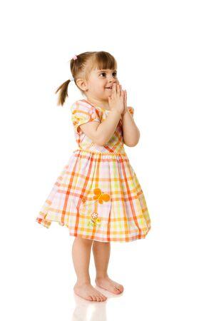 Little girl wearing beautiful dress praying isolated on white photo