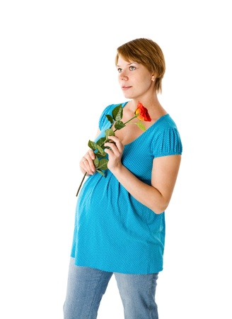 Pregnant woman posing holding rose isolated on white photo