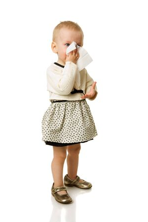 Sick girl sneezing standing isolated on white photo