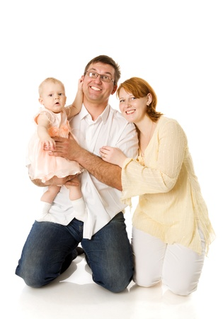 Happy Family of mother father and one year baby isolated photo