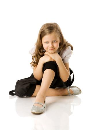 Happy Little girl sitting isolated on white Stock Photo - 9021886