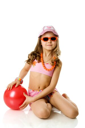 little girl sitting: Happy summer girl wearing panama, sunglasses isolated on white