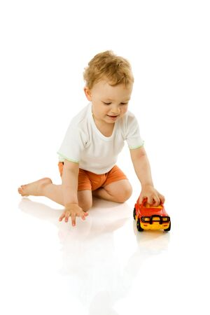 interested baby: Happy Boy holding toy car laughing isolated on white