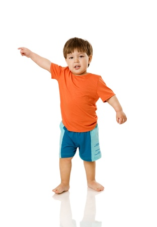 Two years boy standing pointing up isolated on white photo