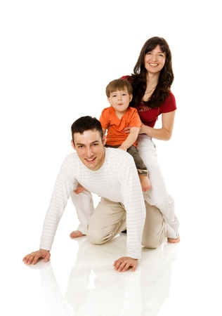 Happy Family with son together isolated on white photo