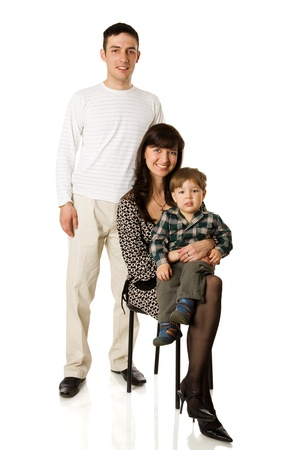 Happy young family portrait isolated on white photo