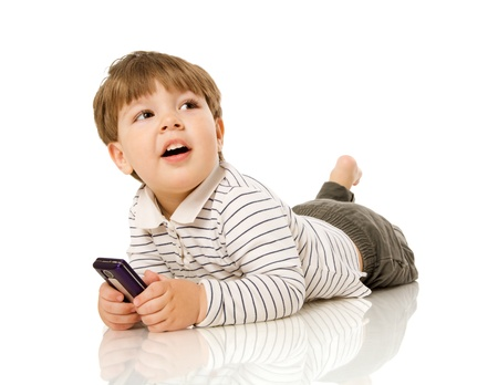 Two years boy smiling sitting on floor isolated on white photo