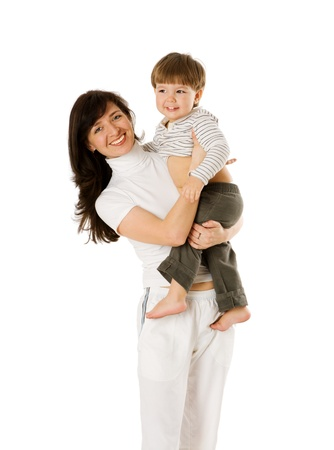 two years: Happy mother holding two years son isolated on white