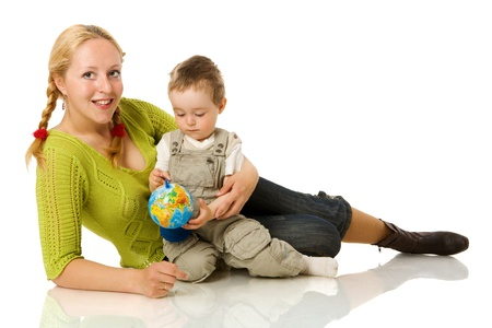 Happy mother holding globe with son isolated on white Stock Photo - 9239527